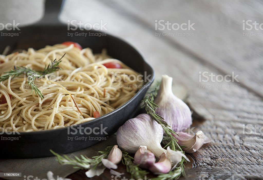Spaghetti pasta in a cast iron frying pan royalty-free stock photo