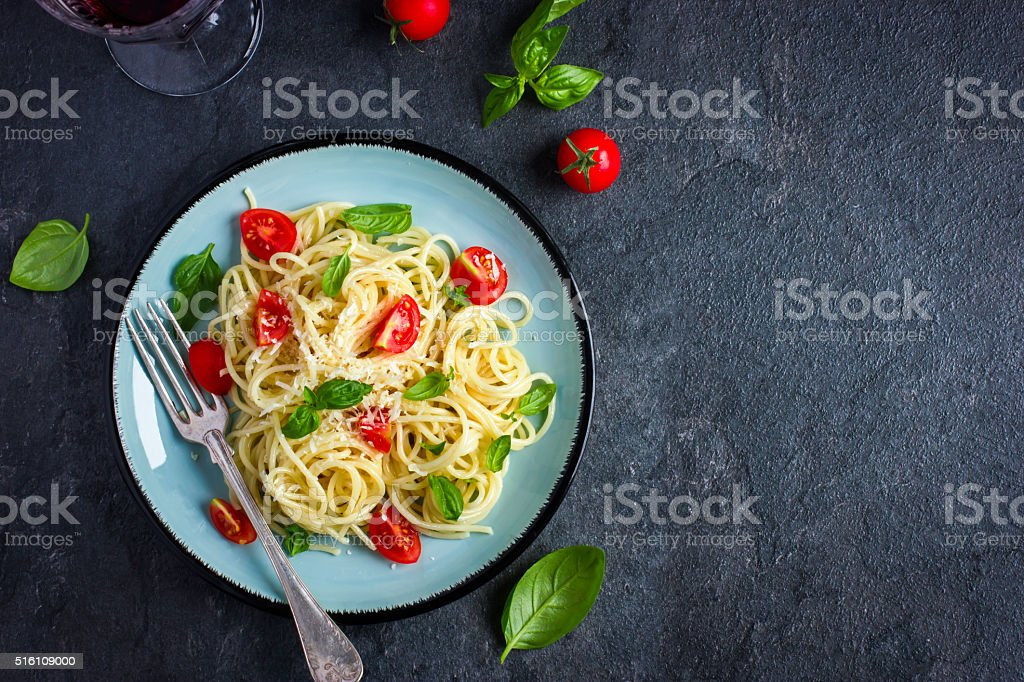 Spaghetti pasta  with cherry tomatoes,  basil and parmesan chees stock photo
