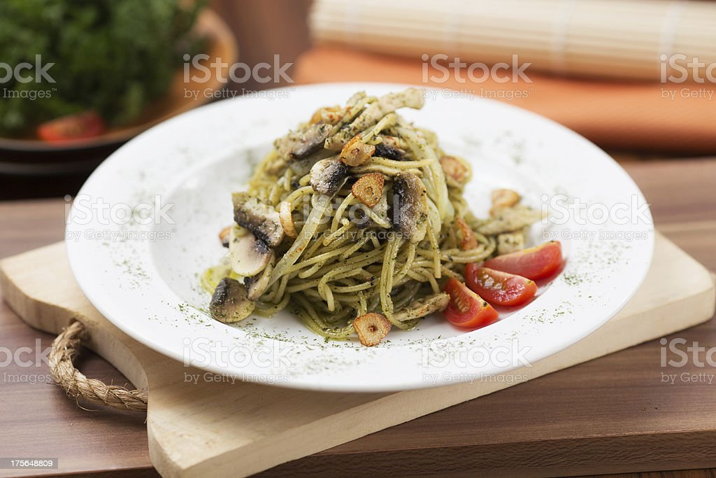 Spaghetti Pesto with Chicken and Egg royalty-free stock photo