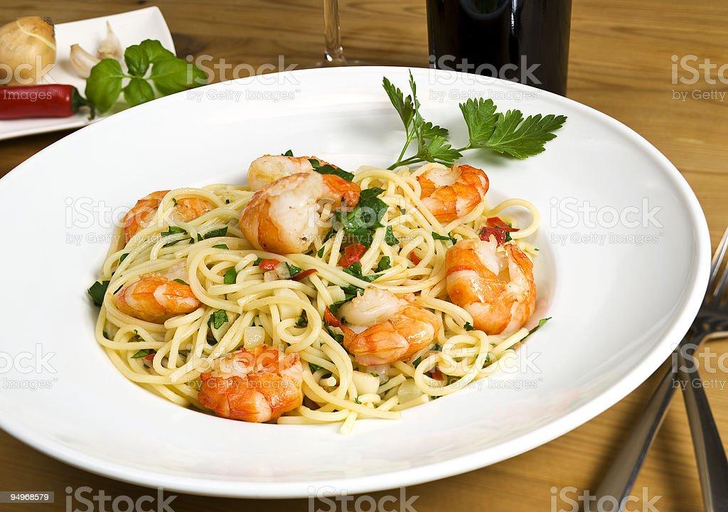 spaghetti scampi meal stock photo