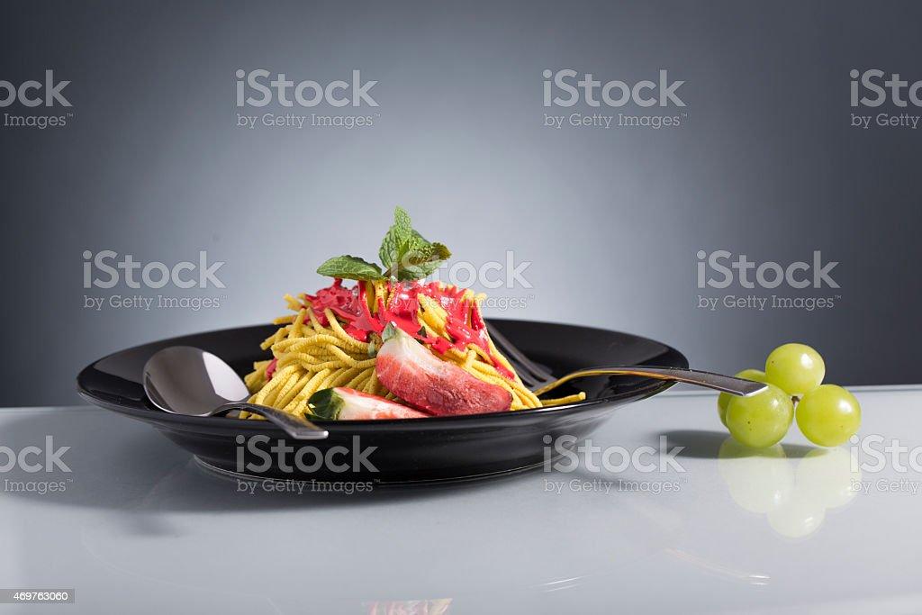 spaghetti sundae, with strawberry decorated stock photo
