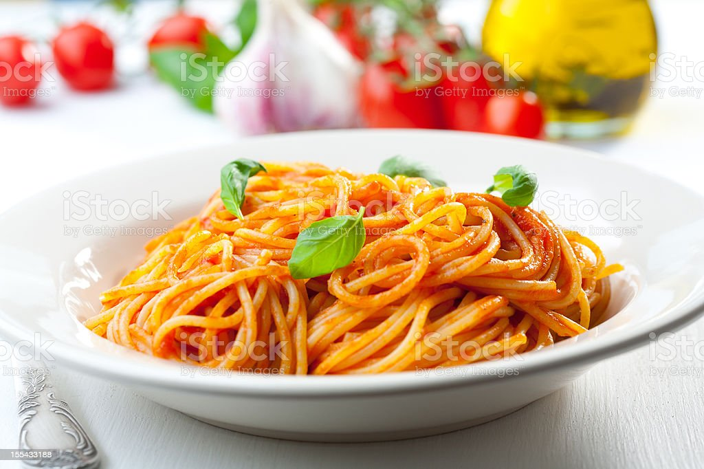 Spaghetti, tomato and basil stock photo