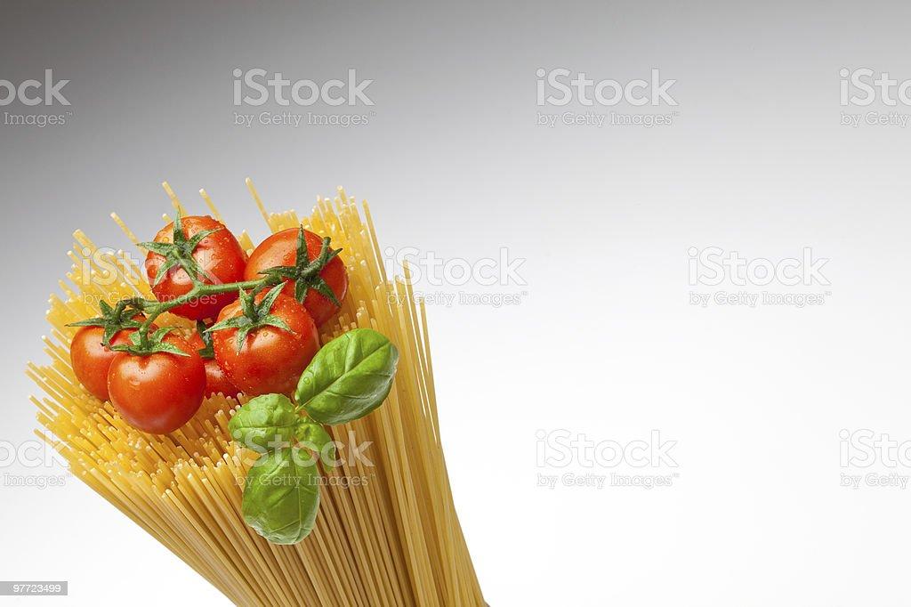 Spaghetti, tomatoes and basil royalty-free stock photo