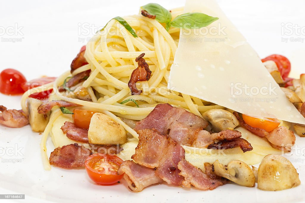 spaghetti with bacon and vegetables royalty-free stock photo