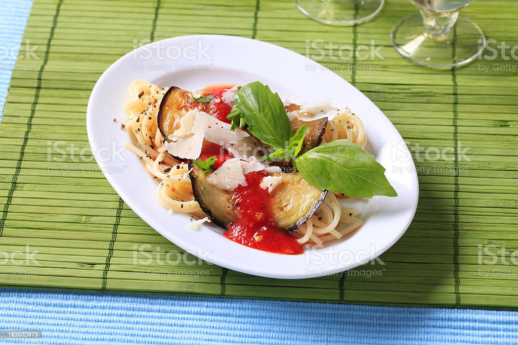 Spaghetti with baked aubergine, tomato puree and Parmesan royalty-free stock photo