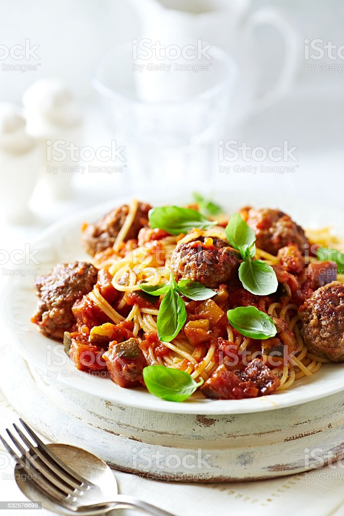 Spaghetti with beef meatballs and vegetable sauce stock photo