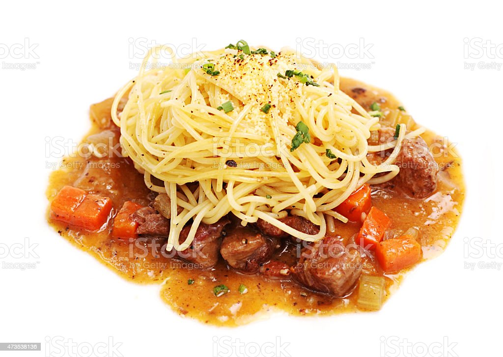 Spaghetti with beef stew and vegetable in gravy sauce stock photo