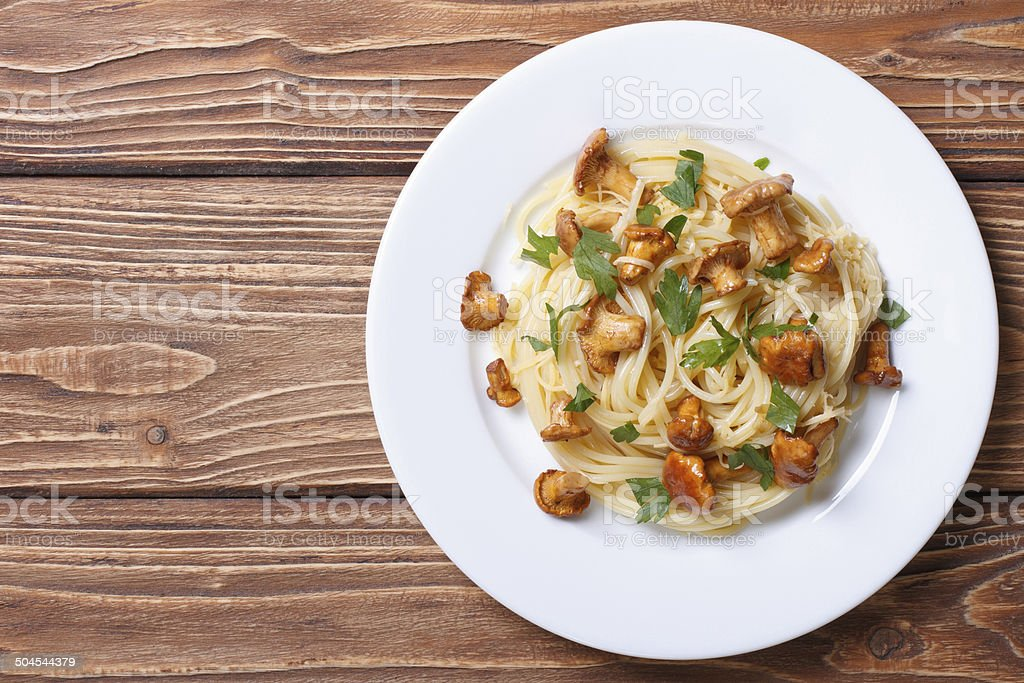 spaghetti with chanterelles mushrooms top view stock photo