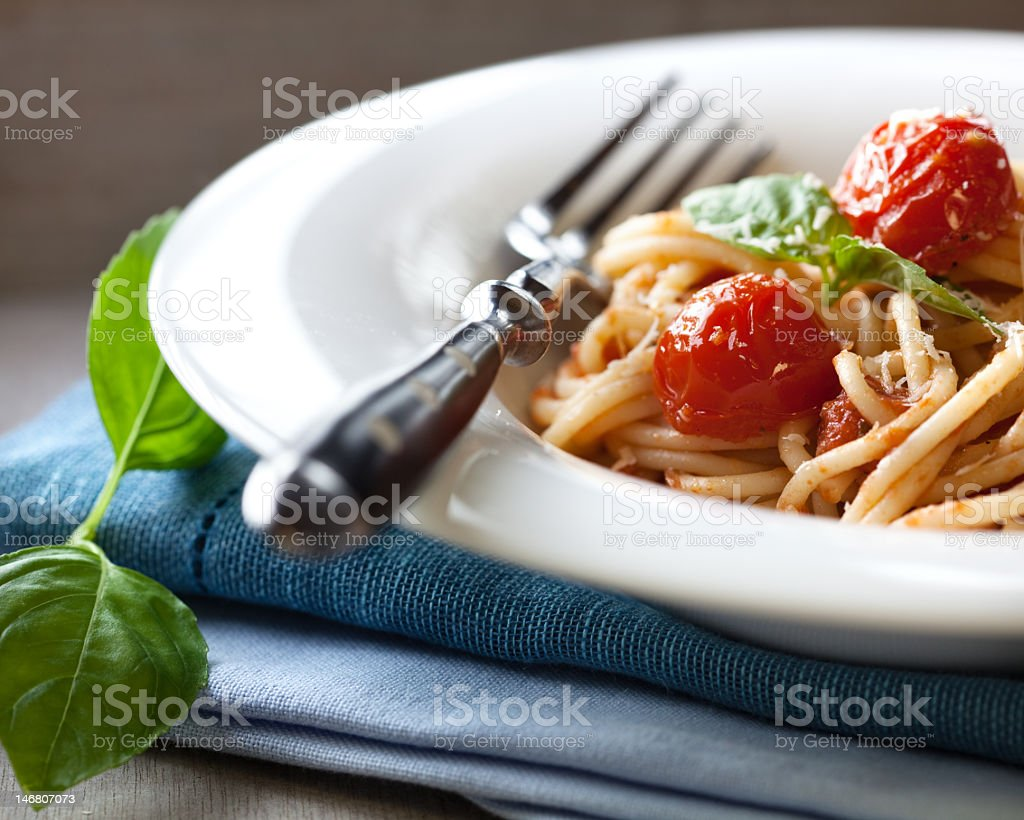 Spaghetti with cherry tomatoes and basil royalty-free stock photo