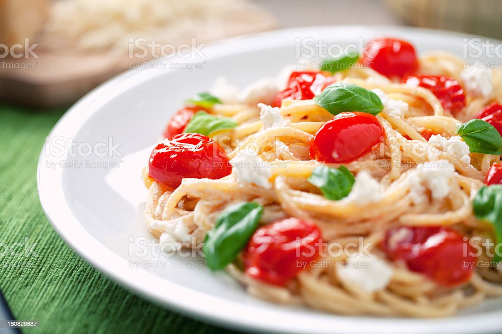 Spaghetti with cherry tomatoes and ricotta royalty-free stock photo