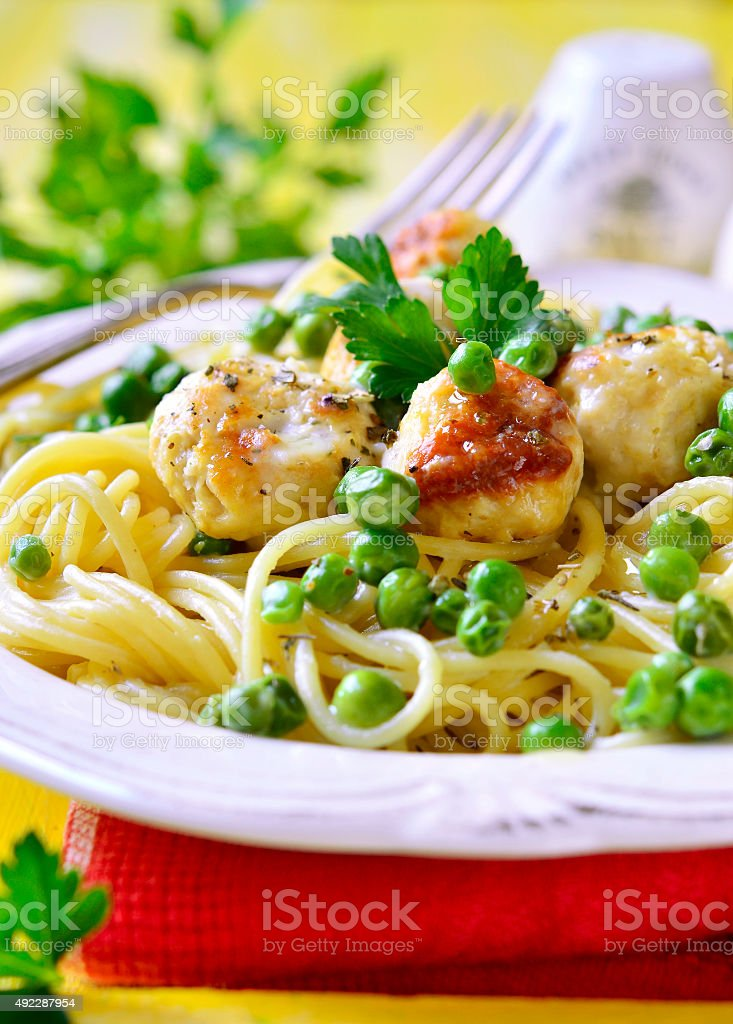 Spaghetti with chicken meatball and green pea. stock photo