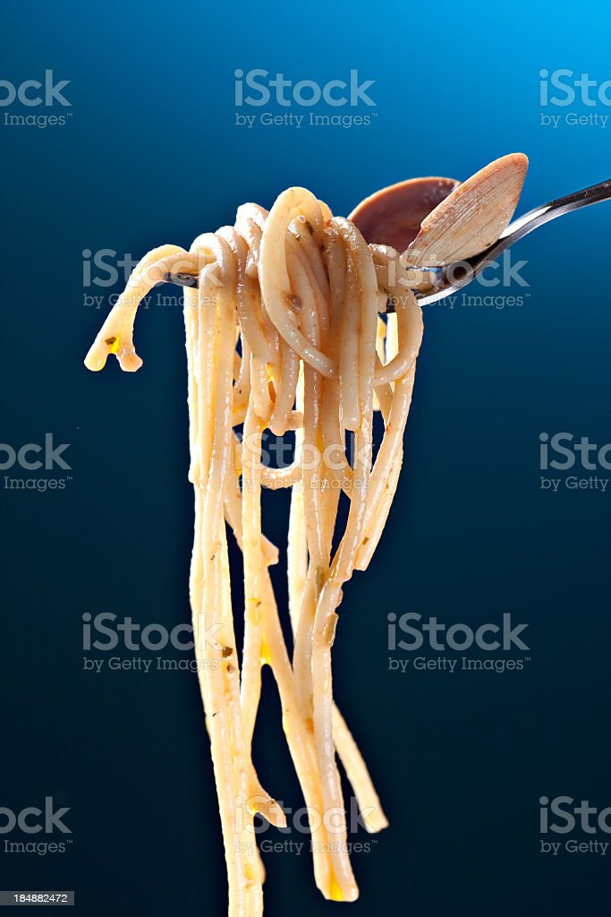 Spaghetti with clams on a red background royalty-free stock photo