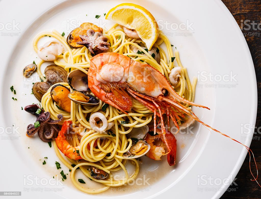 Spaghetti with Clams, Prawns, Seafood Cocktail close up stock photo