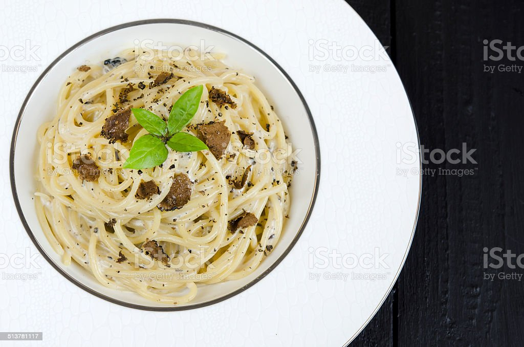 Spaghetti with fresh black truffle stock photo