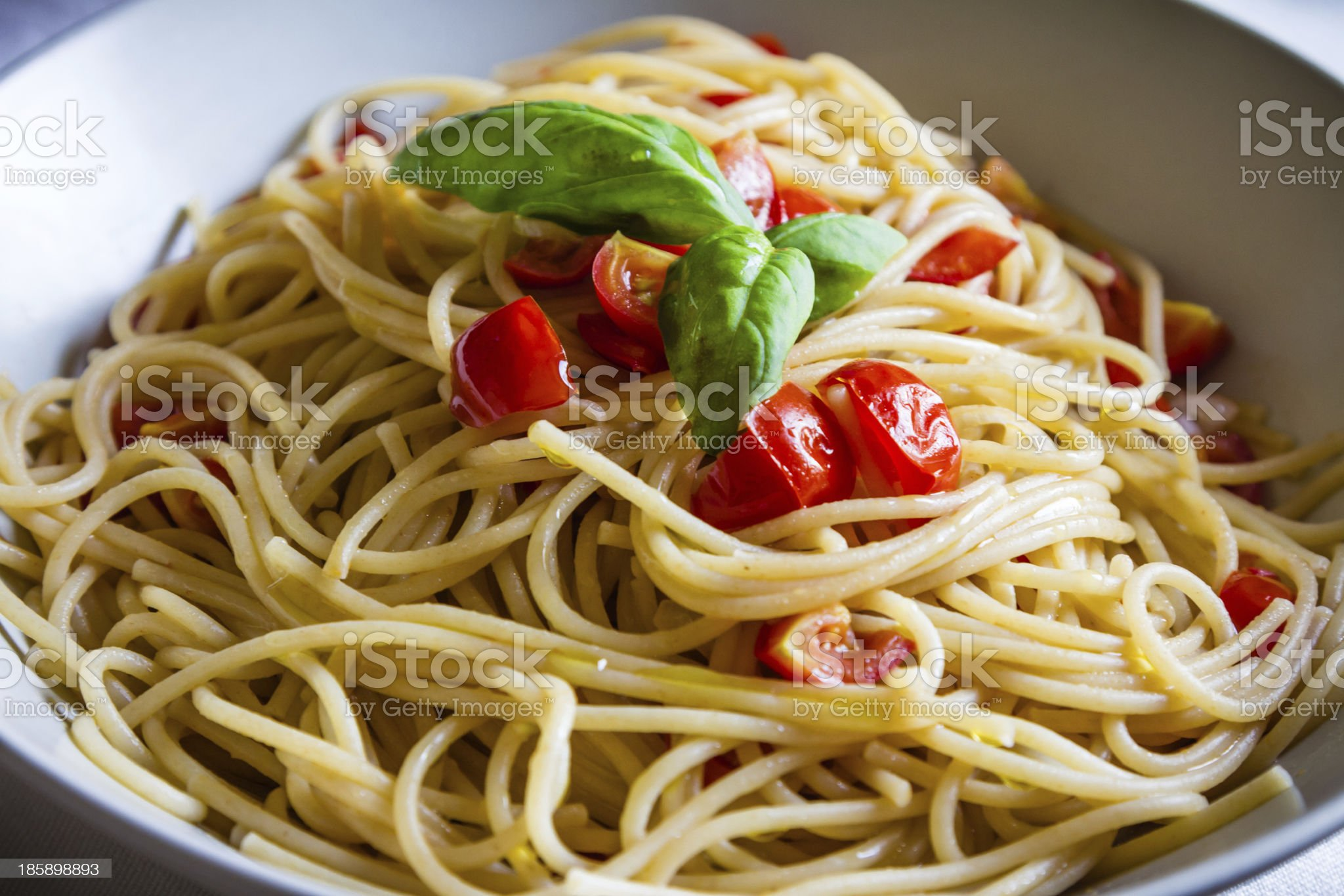 Spaghetti with fresh tomato sauce and basil royalty-free stock photo