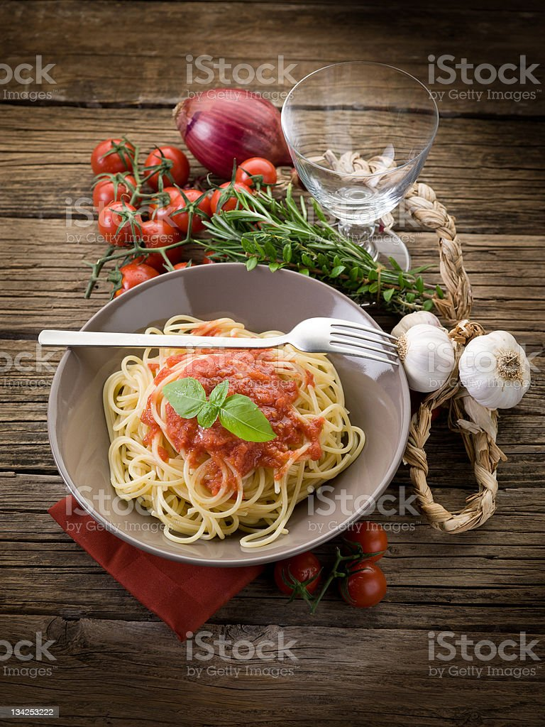 spaghetti with fresh tomatoes sauce and basil royalty-free stock photo