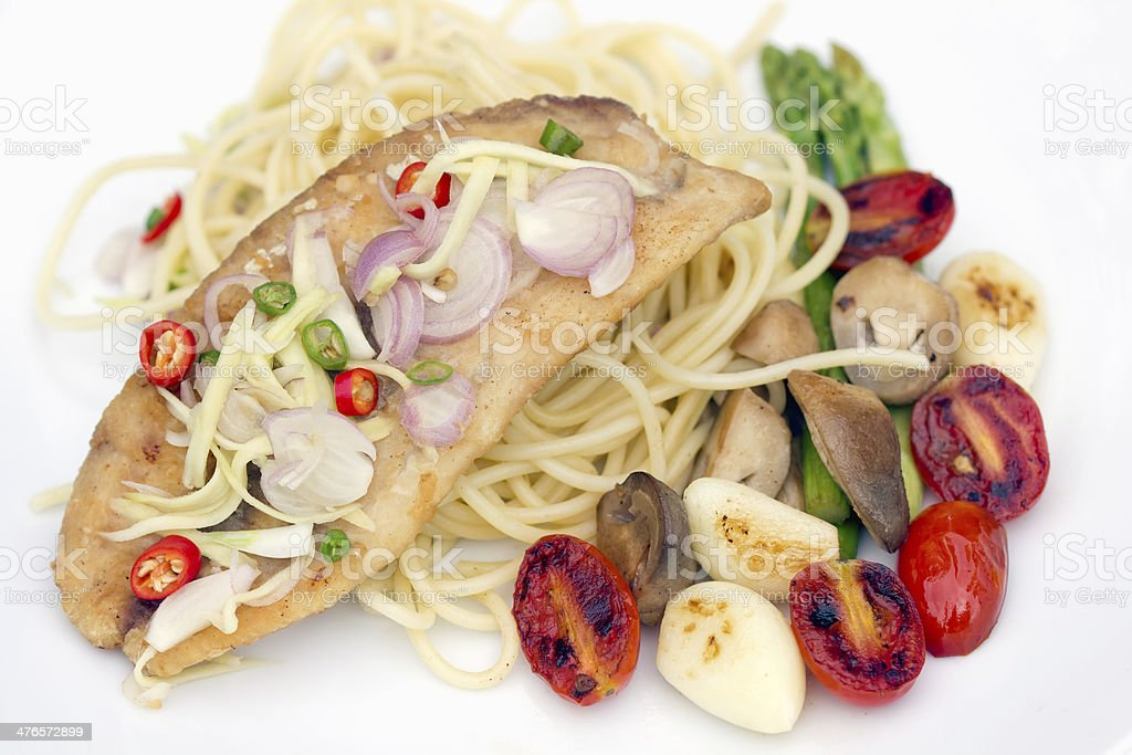 spaghetti with fried fish, garlic and chili in thai cuisine royalty-free stock photo