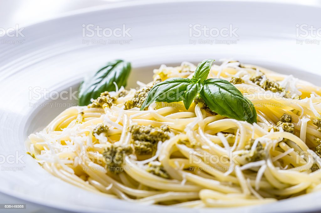 Spaghetti with homemade pesto sauce olive oil and basil leaves stock photo