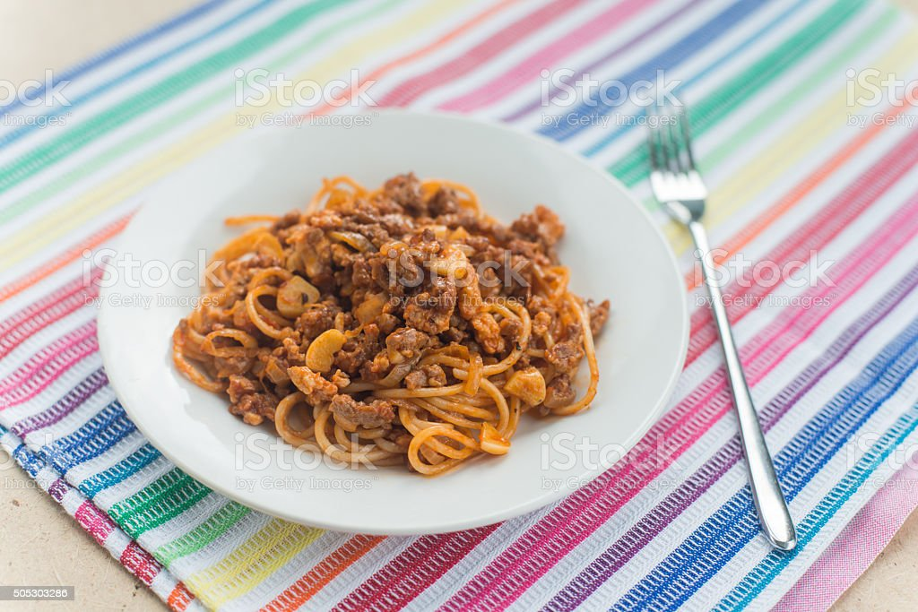 Spaghetti with meat in the white plate stock photo