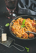 Spaghetti with meatballas, basil leaves, parmesan cheese and red wine