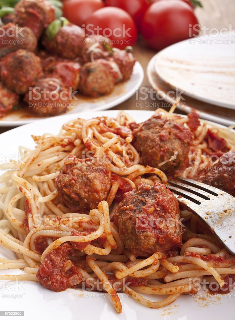 spaghetti with meatballs in tomato sauce on a plate royalty-free stock photo