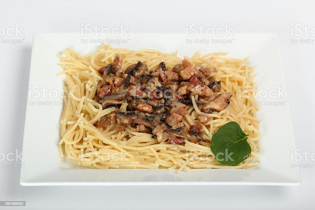 Spaghetti with Mushroom Sauce and Bacon royalty-free stock photo