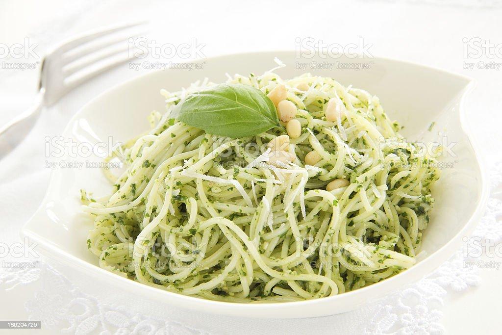 Spaghetti with pesto sauce. stock photo