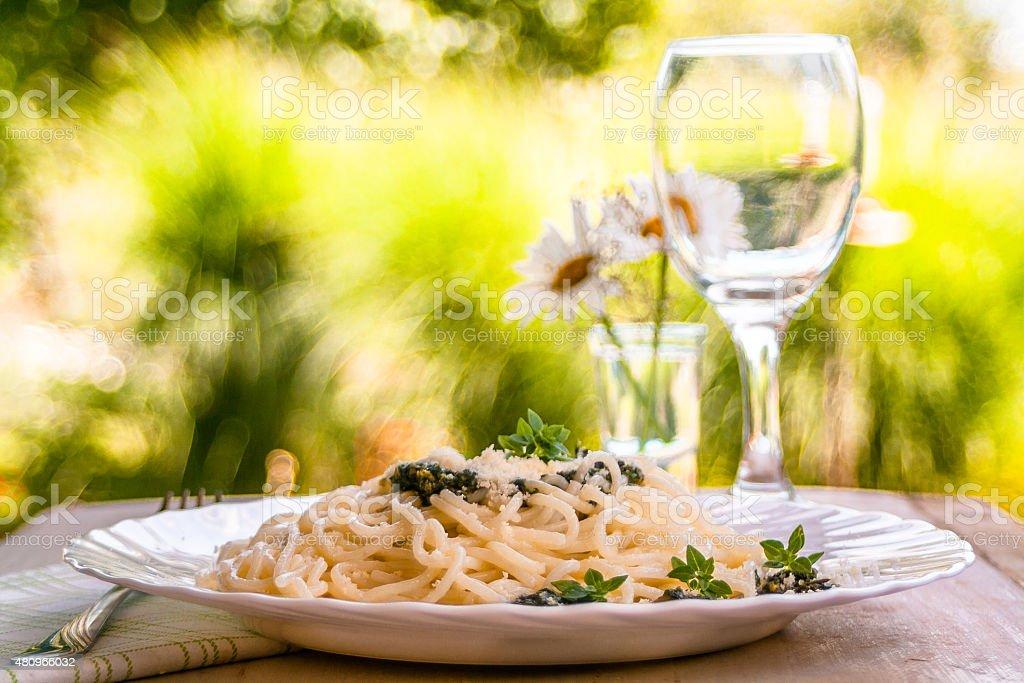 Spaghetti with pesto sauce stock photo