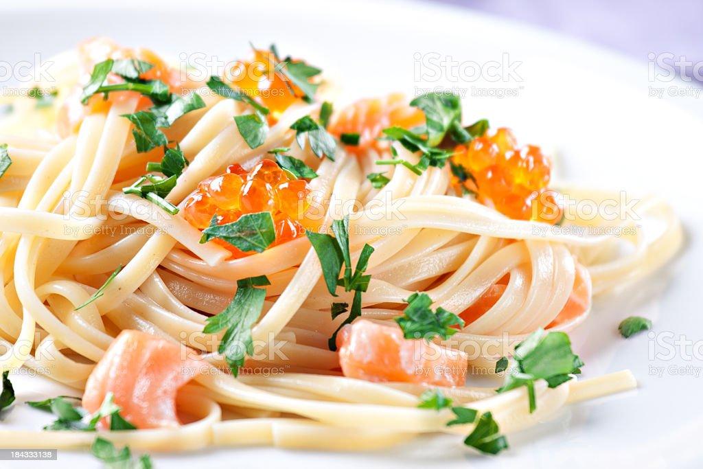 Spaghetti with salmon and caviar stock photo