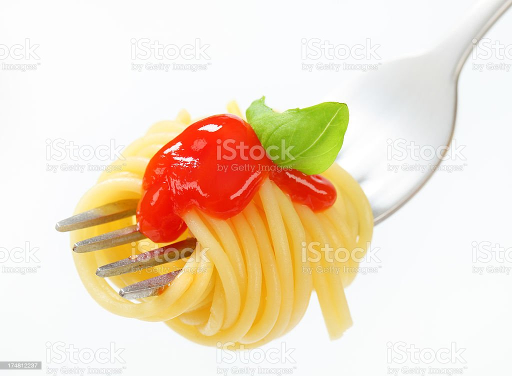 spaghetti with sauce rolled on a fork royalty-free stock photo