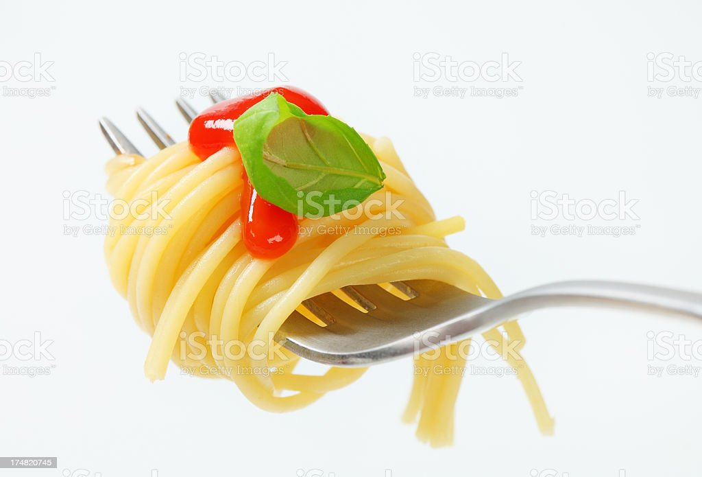 spaghetti with sauce rolled on a fork stock photo