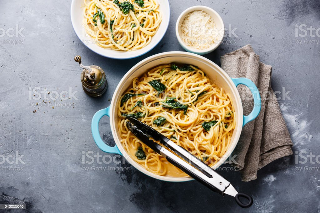 Spaghetti with Spinach and cream sauce in pan stock photo