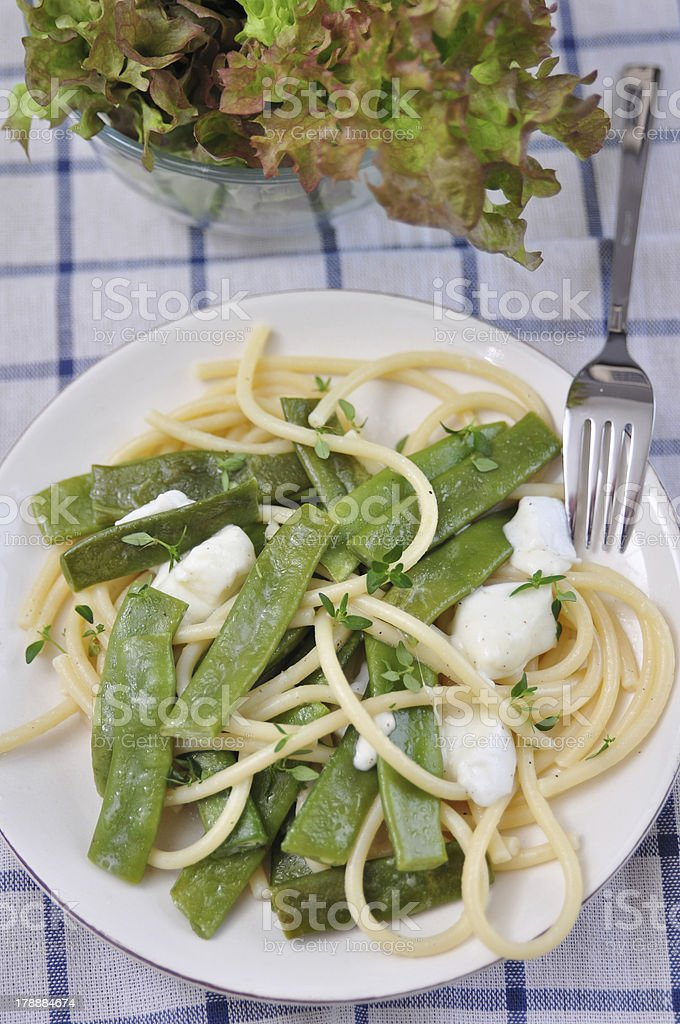 Spaghetti with sugar snap peas and mozzarella royalty-free stock photo