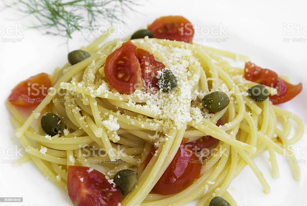 Spaghetti with tomato, capers and anchovies royalty-free stock photo