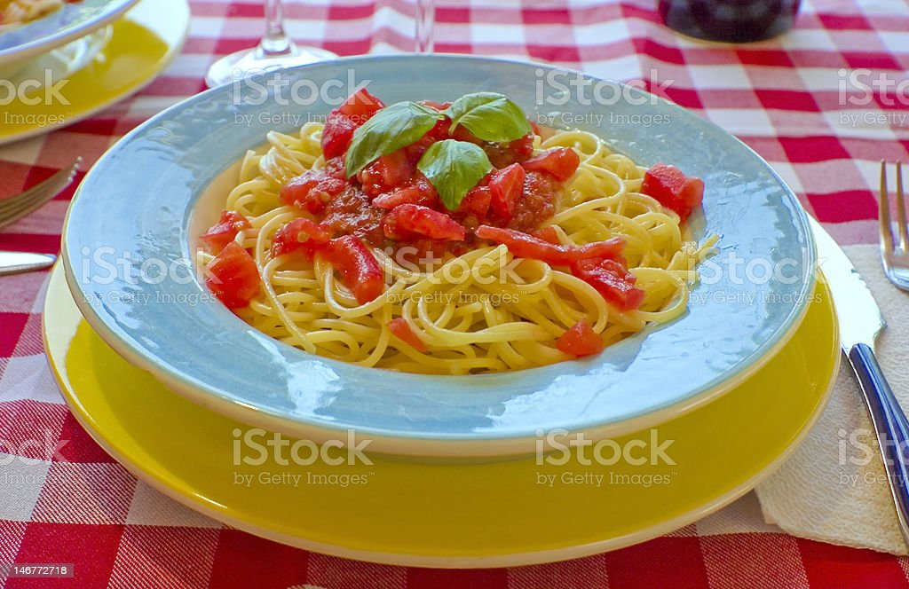Spaghetti with tomato sauce and basil stock photo