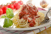 spaghetti with tomato sauce and grated parmesan cheese