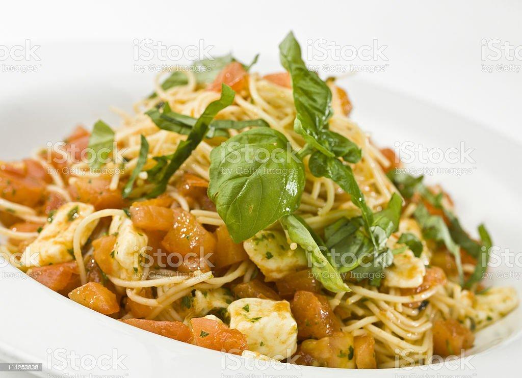 Spaghetti with tomato sauce and mozzarella stock photo