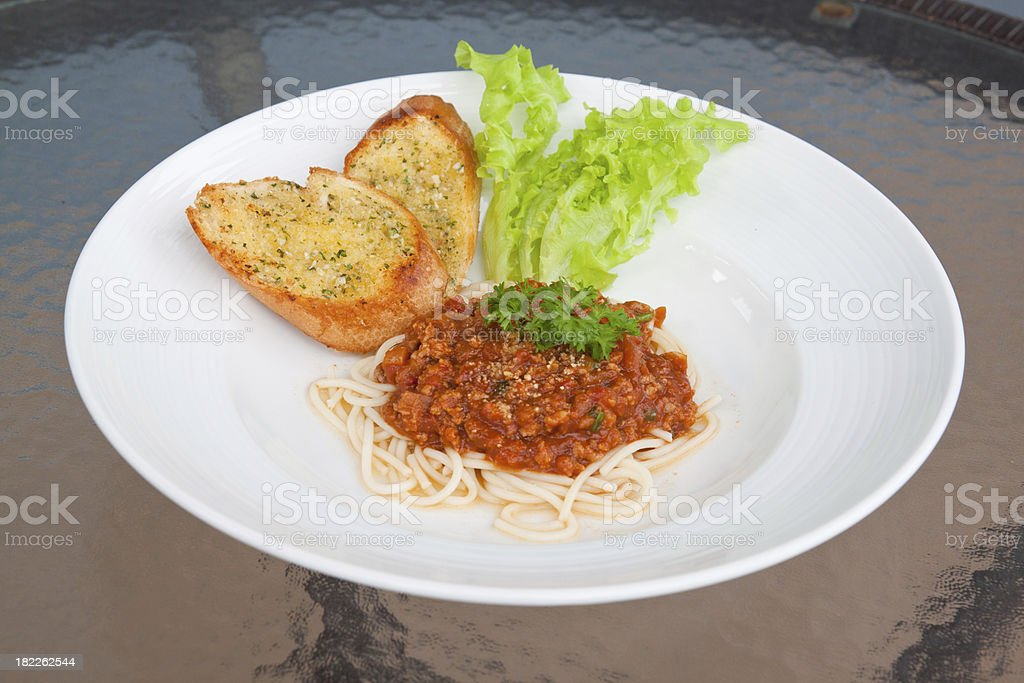 Spaghetti with tomato sauce and pork on the table royalty-free stock photo