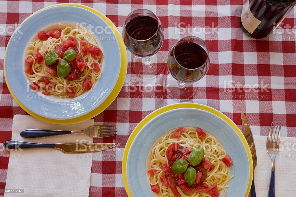 Spaghetti with tomato sauce and red wine stock photo