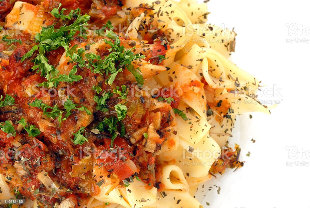 Spaghetti with tomato sauce, meat and garnishing stock photo