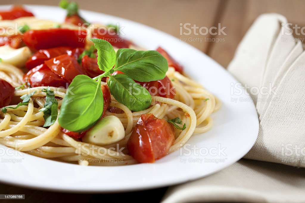 Spaghetti with tomatoes and garlic royalty-free stock photo