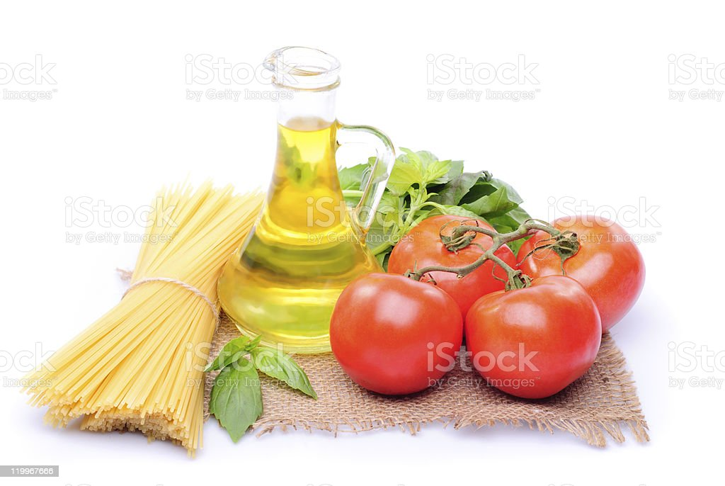 Spaghetti with tomatoes, olive oil and basil royalty-free stock photo