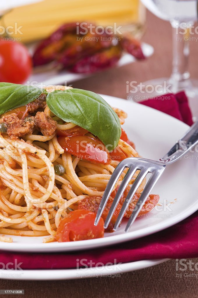 Spaghetti with tuna, cherry tomatoes and capers. royalty-free stock photo