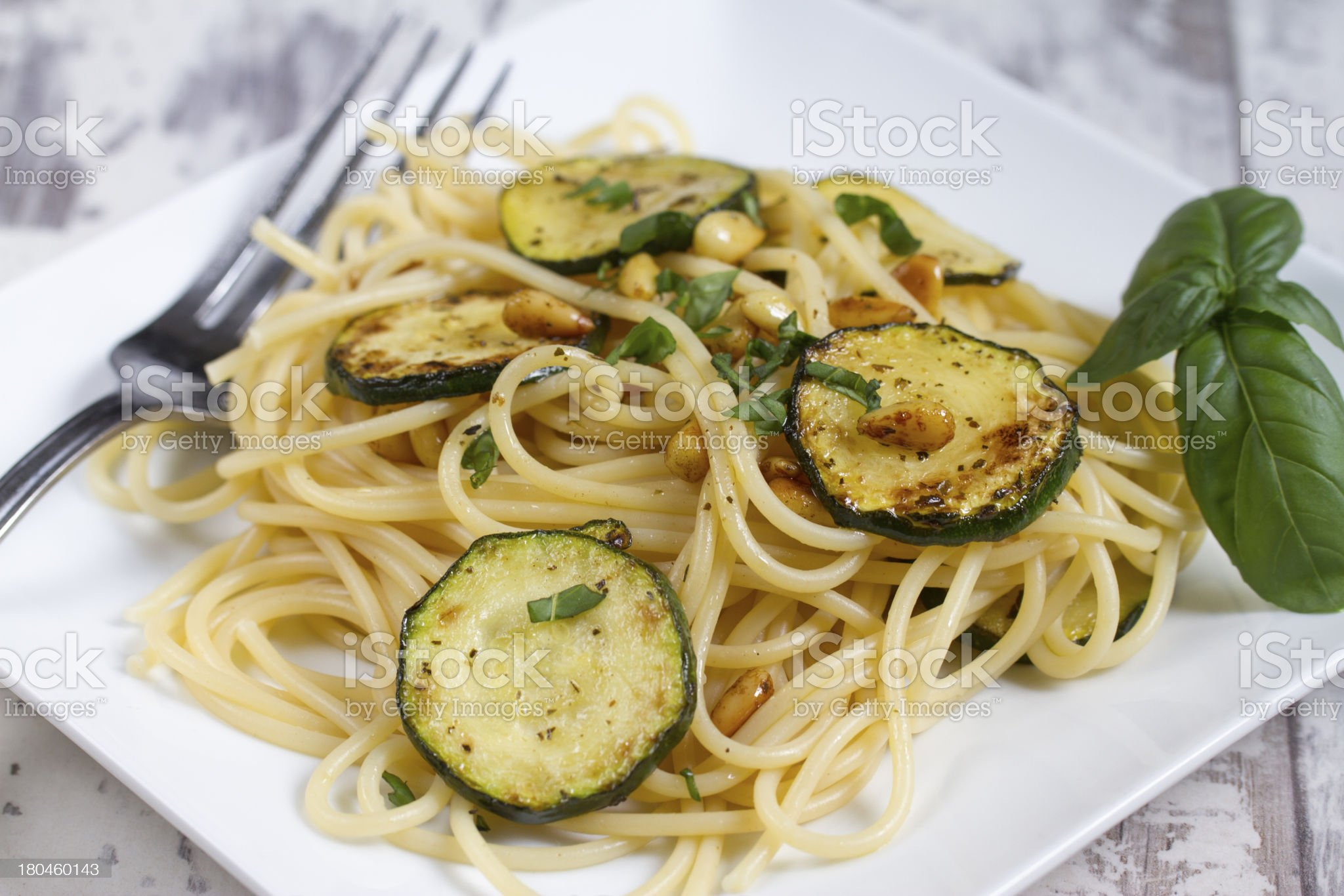 Spaghetti with zucchini and pine nuts royalty-free stock photo