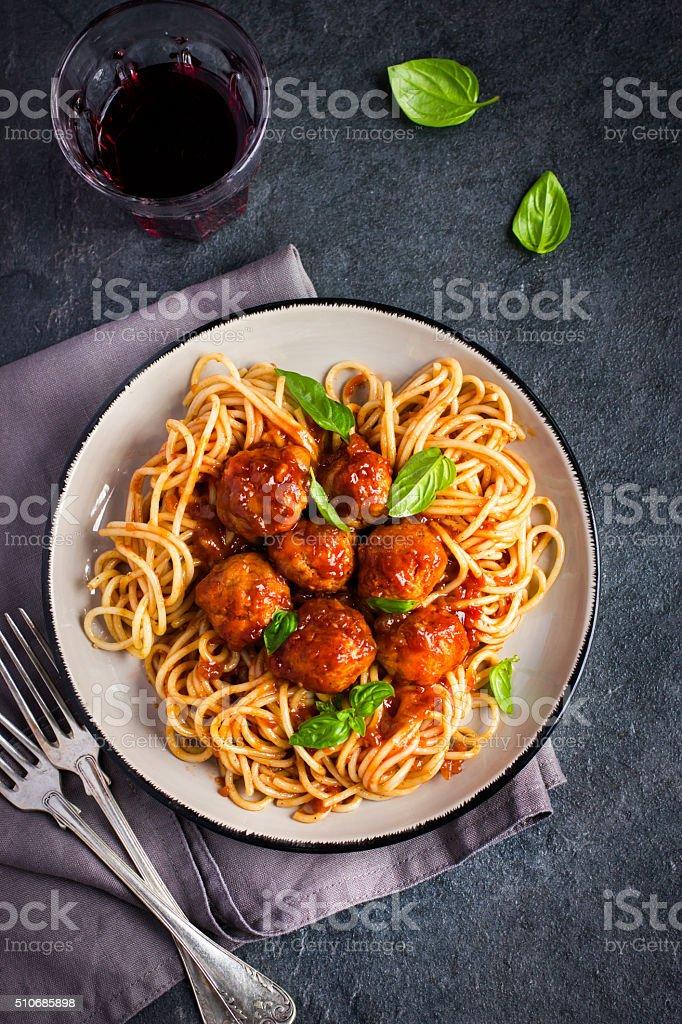 Spaghetty pasta  with meatballs and tomato sauce stock photo