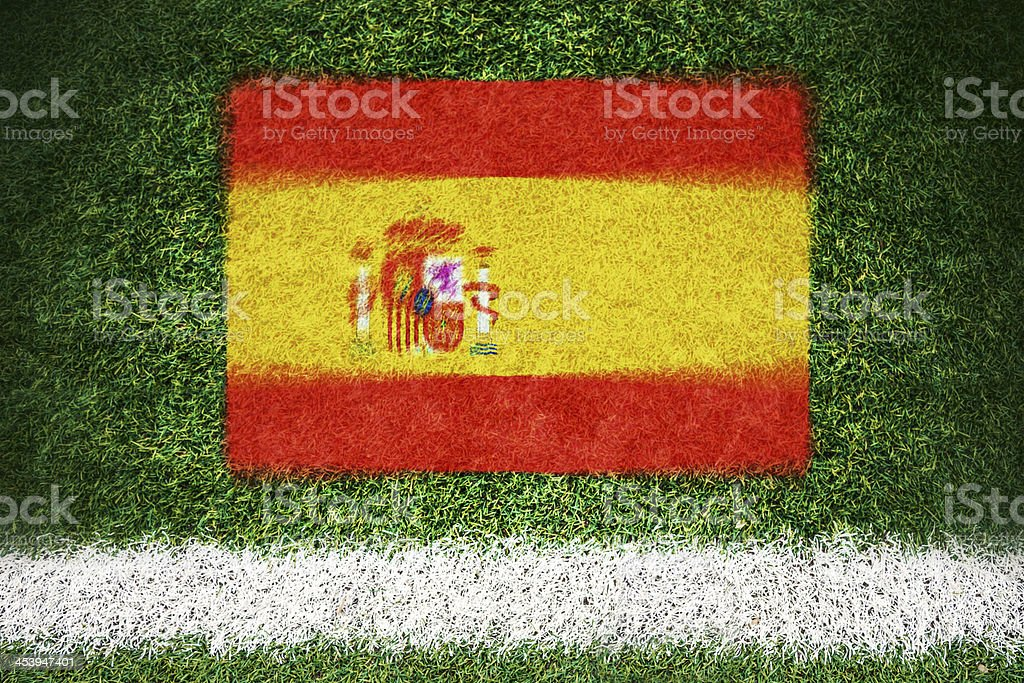 Spain flag printed on a soccer field royalty-free stock photo