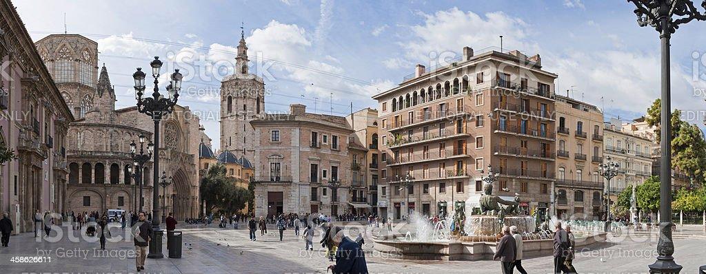 Spain people walking Turia Fountain Plaza de la Virgen Valencia stock photo