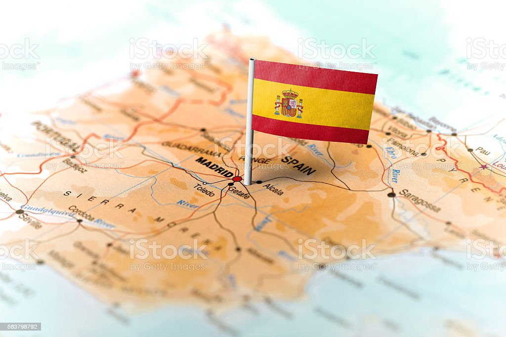 Spain pinned on the map with flag stock photo