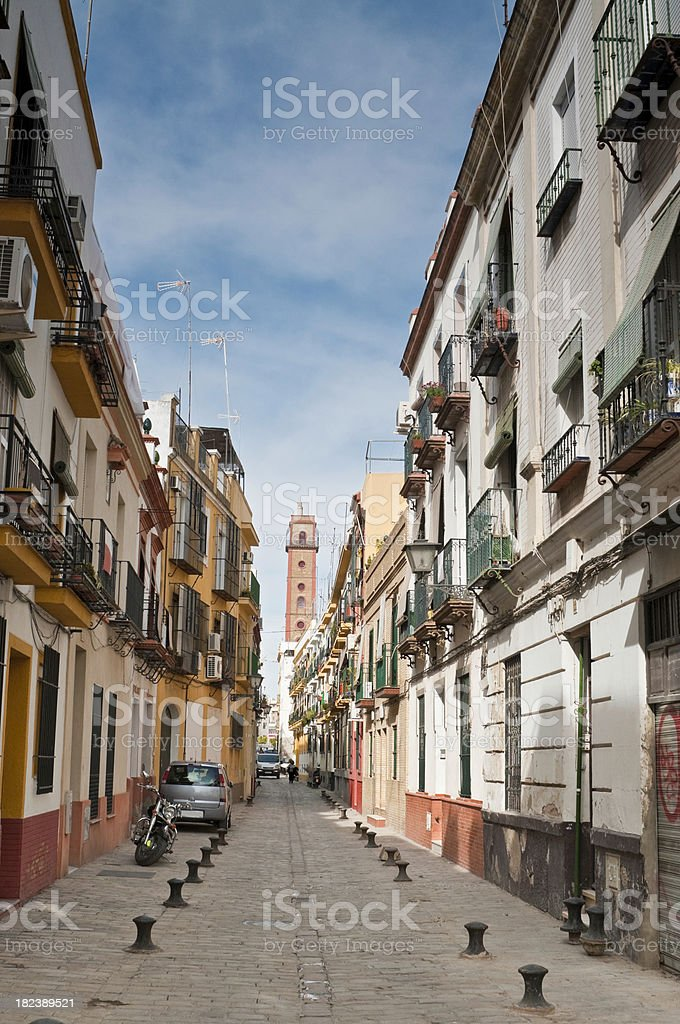 Spain quiet cobbles side street shutters stucco villas Seville Andalusia royalty-free stock photo