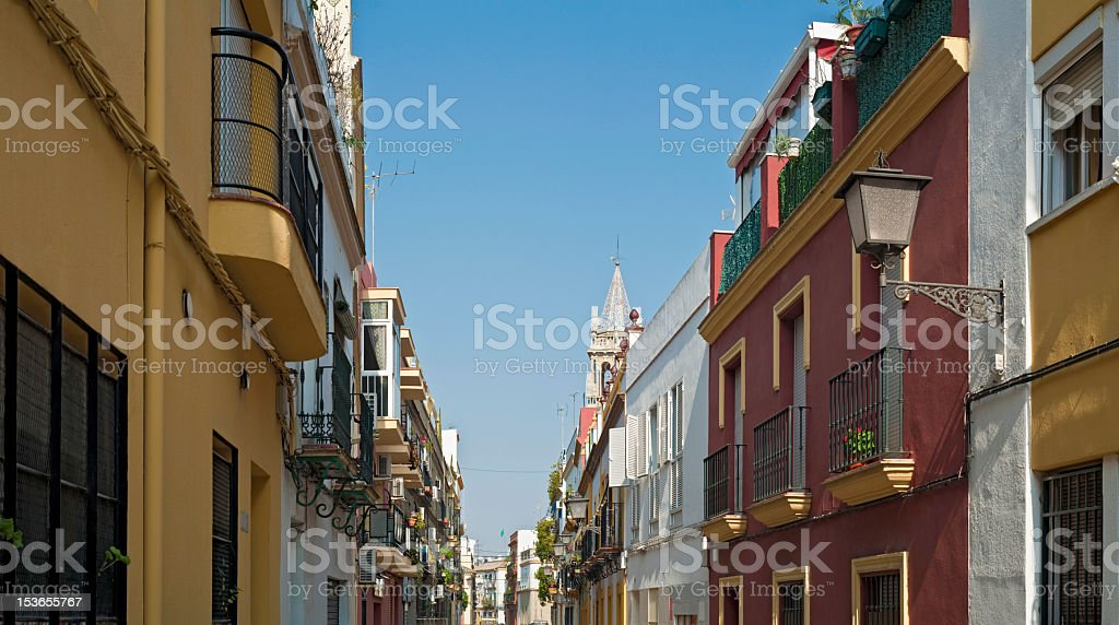Spain tranquil street scene colorful villas townhouses Andalusia Seville panorama stock photo
